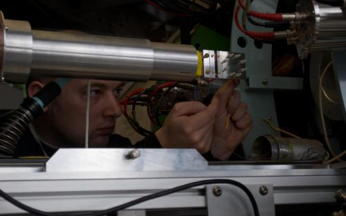 Dr Alan Drew wiring up the electrodes on the multiferroic sample (above), on the